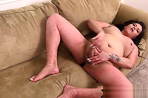 Alluring brunette plays with...