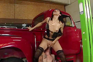 Latex plays with a dude by a car...