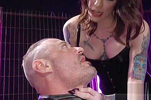 Black latex whips her sub...
