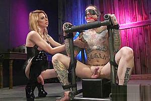 Inked male in bondage dick...