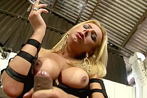 Seductive busty tranny wanking her pecker...