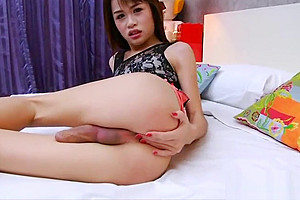 Cute masturbates cock on the bed...
