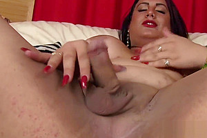 In stockings wanking her cock...