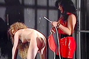 Tranny mistress whips slave...